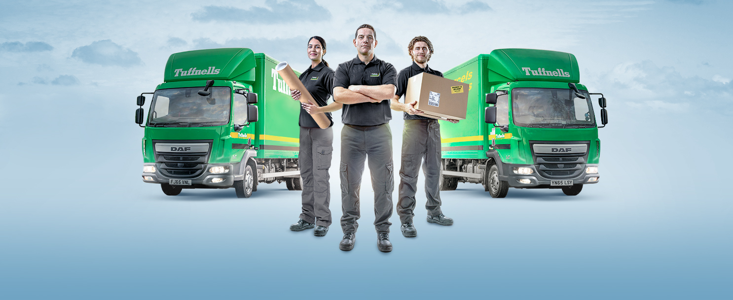Tuffnells' delivery personnel in front of lorries
