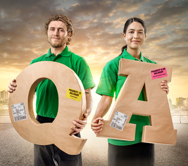 "Man and woman holding ""Q"" and ""A"" shaped parcels"