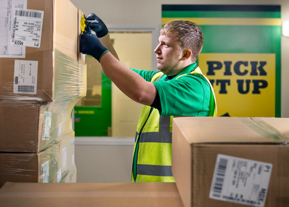 Man putting label on a parcel